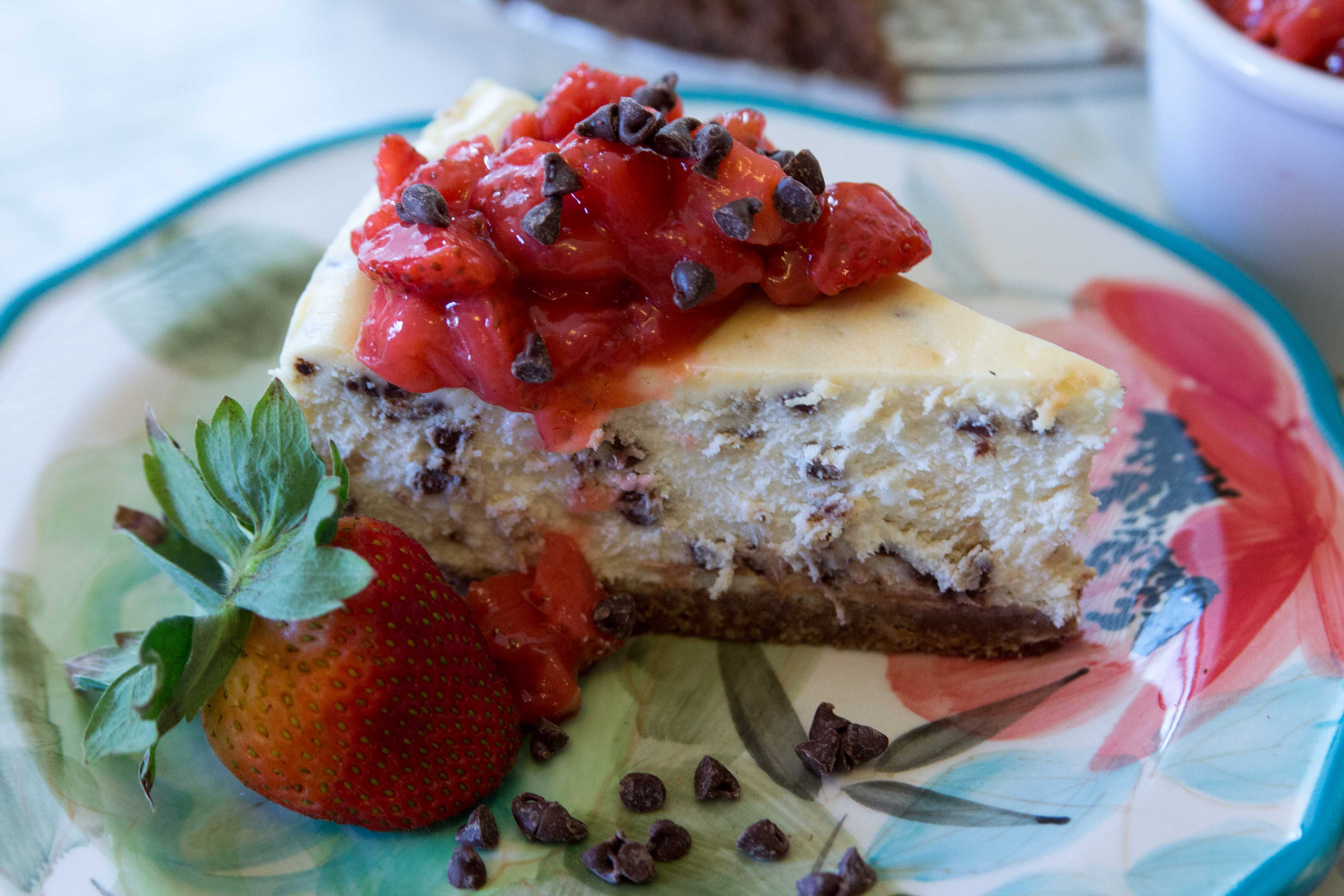 Chocolate Chip Cheesecake with Strawberry Compote Topping